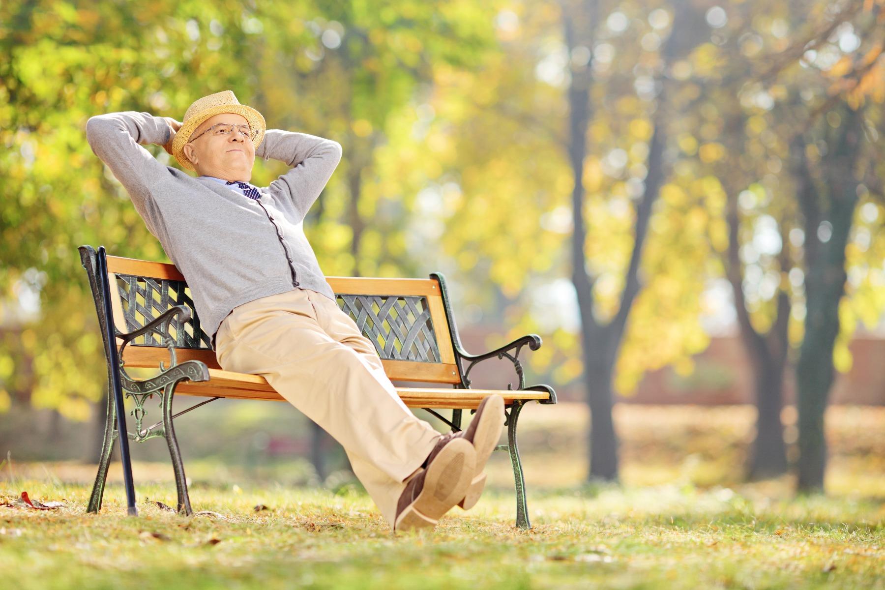 A man sat on a bench.